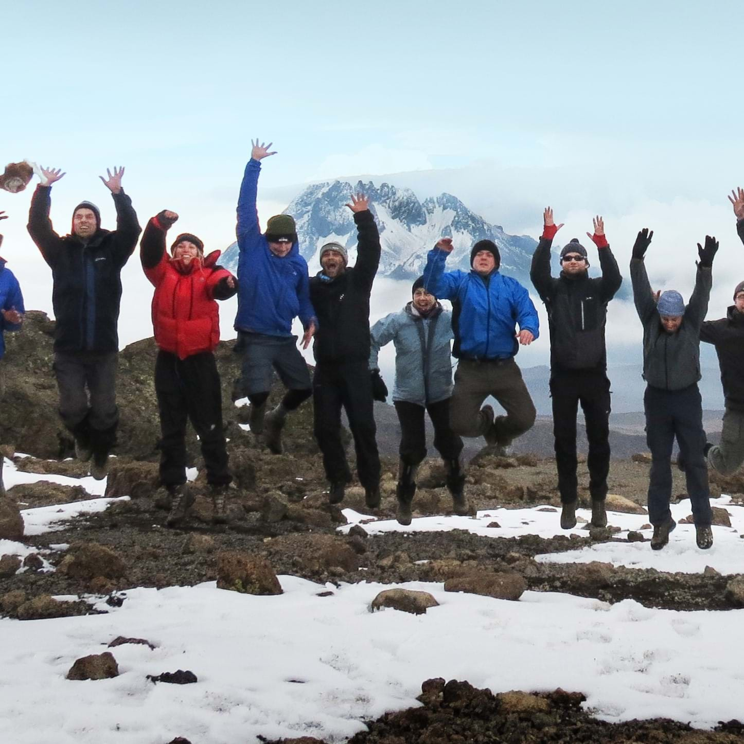 Group jumping having climbed Kilimanjaro