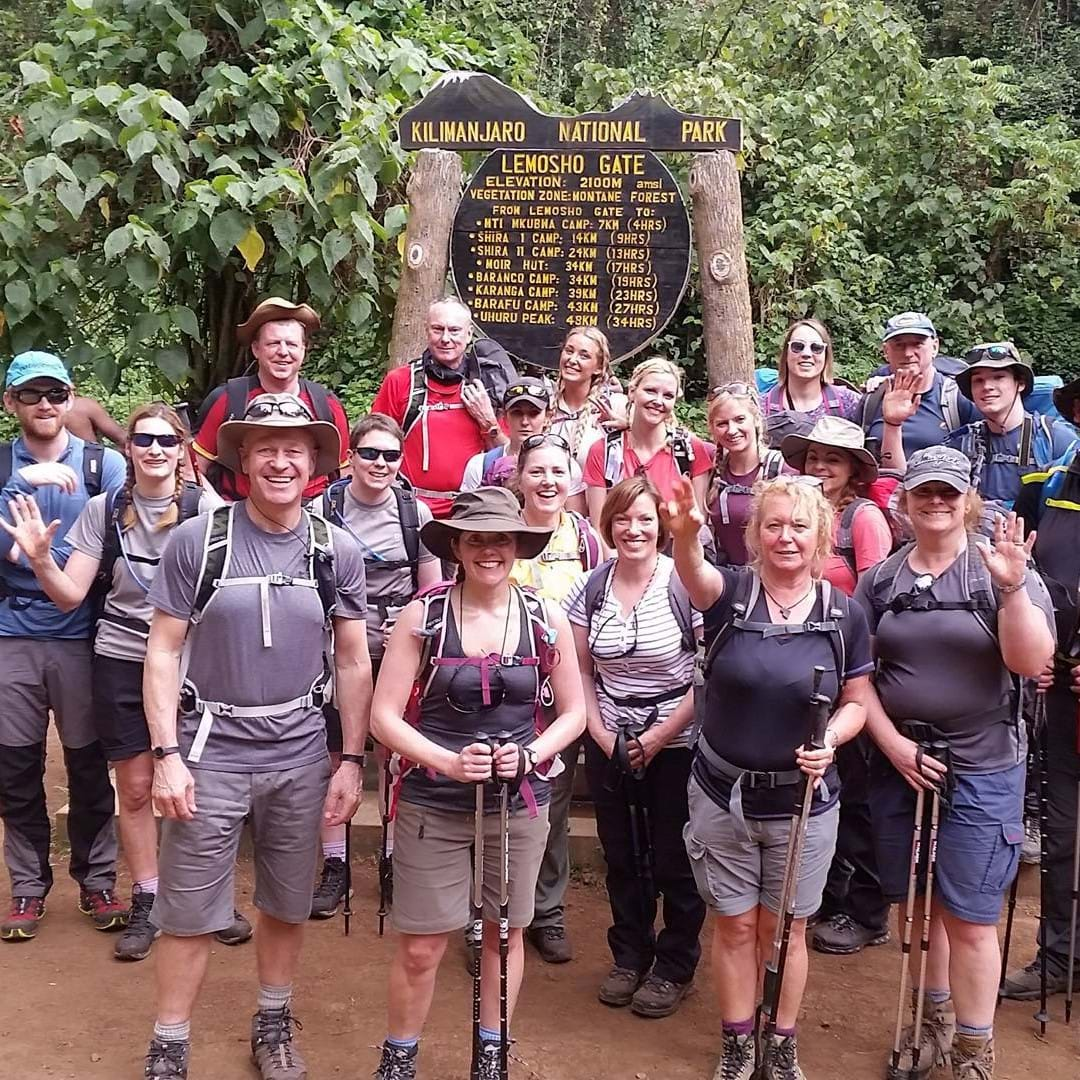 Group of Dream Challenges participants celebrate at the peak of Mount Kilimanjaro